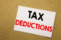 Conceptual hand writing text caption inspiration showing Tax Deductions. Business concept for Finance Incoming Tax Money Deduction. Written on sticky note Royalty Free Stock Photos