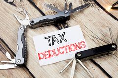 Conceptual hand writing text caption inspiration showing Tax Deductions. Business concept for Finance Incoming Tax Money Deduction. Written on old wooden Stock Images