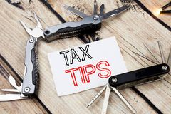 Conceptual hand writing text caption inspiration showing Tax Tips. Business concept for Taxpayer Assistance Refund Reimbursement W. Ritten on old wooden Stock Photos