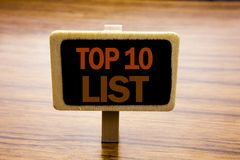 Conceptual hand writing text caption inspiration showing Top 10 Ten List. Business concept for Success ten list written on announc. Ement board on wooden wood stock photos