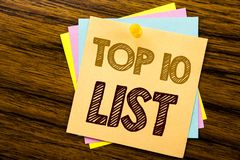 Conceptual hand writing text caption inspiration showing Top 10 Ten List. Business concept for Success ten list written on sticky. Note paper on wooden Royalty Free Stock Photos