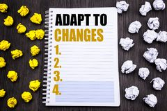 Conceptual hand writing text caption showing Adapt To Changes. Business concept for Adaptation New Future Written on notepad note. Conceptual hand writing text Royalty Free Stock Images