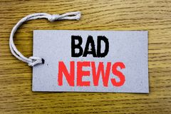 Conceptual hand writing text caption showing Bad News. Business concept for Failure Media Newspaper written on price tag paper wit. H copy space on wooden Royalty Free Stock Image