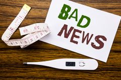 Conceptual hand writing text caption showing Bad News. Business concept for Failure Media Newspaper written on sticky note paper o. Conceptual hand writing text Stock Photos