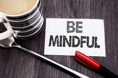 Conceptual hand writing text caption showing Be Mindful. Business concept for Mindfulness Healthy Spirit written on sticky note pa. Per on wooden wood background Stock Photos