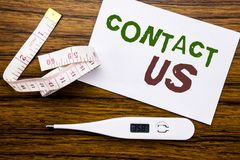 Conceptual hand writing text caption showing Contact Us. Business concept for Customer Support written on sticky note paper on woo. Conceptual hand writing text royalty free stock photos