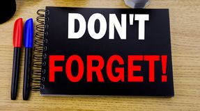 Conceptual hand writing text caption showing Do Not Forget. Business concept for Reminder Message written on sticky note with spac Stock Photos