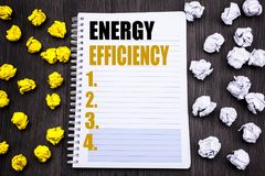 Conceptual hand writing text caption showing Energy Efficiency. Business concept for Electricity Ecology Written on notepad note n. Conceptual hand writing text royalty free stock image