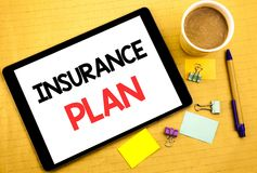 Conceptual hand writing text caption showing Insurance Plan. Business concept for Health Life Insured Written on tablet laptop, wo. Conceptual hand writing text Stock Photography