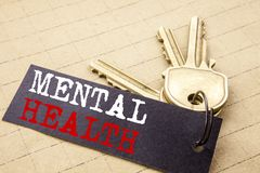 Conceptual hand writing text caption showing Mental Health. Business concept for Anxiety Illness Disorder written on note paper at. Tached to keys note paper on stock image