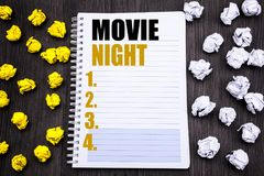 Conceptual hand writing text caption showing Movie Night. Business concept for Wathing Movies Written on notepad note notebook bo. Conceptual hand writing text royalty free stock photo