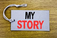 Conceptual hand writing text caption showing My Story. Business concept for Telling Tell About You written on price tag paper with. Copy space on wooden vintage Stock Photo
