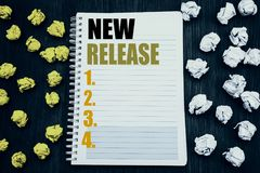 Conceptual hand writing text caption showing New Release . Business concept for Technology Software Update Written on notepad note. Conceptual hand writing text royalty free stock image