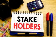 Conceptual hand writing text caption showing Stake Holders. Business concept for Stakeholder Engagement written on notebook book o. N the background in the royalty free stock photography