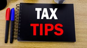 Conceptual hand writing text caption showing Tax Tips. Business concept for Taxpayer Assistance Refund Reimbursement written on st. Icky note with copy space on Stock Image