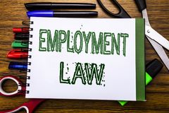 Conceptual hand writing text Employment Law.  Concept for Employee Legal Justice Written on notebook, wooden background with offic. Conceptual hand writing text Royalty Free Stock Image