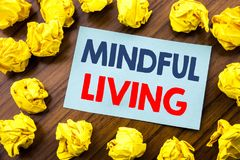 Conceptual hand writing text inspiration showing Mindful Living. Business concept for Life Happy Awareness written on sticky note. Paper the wooden background Stock Photos
