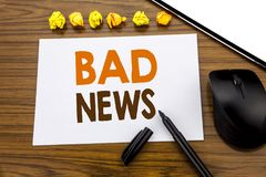 Conceptual hand writing text showing Bad News. Business concept for Failure Media Newspaper written on sticky note paper on the wo. Conceptual hand writing text Stock Photo