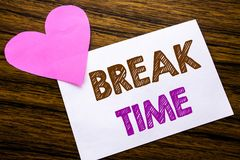 Conceptual hand writing text showing Break Time. Concept for Stop Pause From Work Workshop written on sticky note paper, wooden wo Stock Images