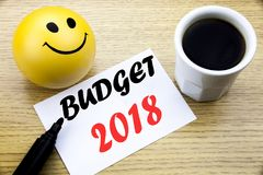 Conceptual hand writing text showing Budget 2018. Business concept for Household budgeting accounting planning written sticky note. Paper, Wooden background stock images