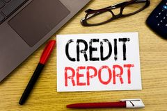 Conceptual hand writing text showing Credit Report. Business concept for Finance Score Check written on paper, wooden background i. N office copy space, marker stock image
