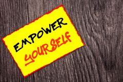 Conceptual hand writing text showing Empower Yourself. Concept meaning Positive Motivation Advice For Personal Development written. Yellow Sticky Note Paper the Royalty Free Stock Photography