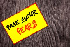 Conceptual hand writing text showing Face Your Fears. Concept meaning Challenge Fear Fourage Confidence Brave Bravery written on Y. Conceptual hand writing text royalty free stock photos