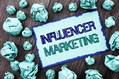 Conceptual hand writing text showing Influancer Marketing. Concept meaning Social Media Online Influence Strategy written on Stick. Conceptual hand writing text Stock Photography