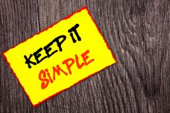 Conceptual hand writing text showing Keep It Simple. Concept meaning Simplicity Easy Strategy Approach Principle written on Yellow. Conceptual hand writing text Stock Photo