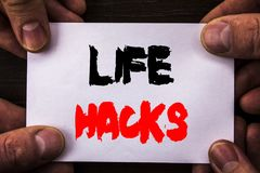 Conceptual hand writing text showing Life Hacks. Concept meaning Solution Hacking Hack Trick To Help Efficiency written on Sticky. Conceptual hand writing text Stock Photos