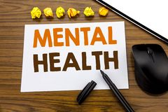 Conceptual hand writing text showing Mental Health. Business concept for Anxiety Illness Disorder written on sticky note paper on. Wooden background with marker stock images