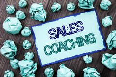Conceptual hand writing text showing Sales Coaching. Concept meaning Business Goal Achievement Mentoring written on Sticky note pa. Conceptual hand writing text Royalty Free Stock Image