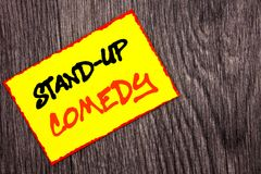 Conceptual hand writing text showing Stand Up Comedy. Concept meaning Entertainment Club Fun Show Comedian Night written on Yellow stock images