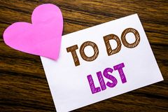 Conceptual hand writing text showing To Do List. Concept for Plan Lists Remider written on sticky note paper, wooden wood backgrou Royalty Free Stock Photography
