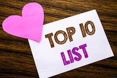 Conceptual hand writing text showing Top 10 Ten List. Concept for Success ten list written on sticky note paper, wooden wood backg. Conceptual hand writing text Stock Photography