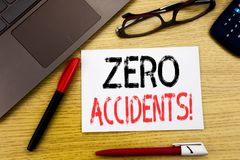 Conceptual hand writing text showing Zero Accidents. Business concept for Safety At Work Hazard written on paper, wooden backgroun. D in office copy space Royalty Free Stock Images