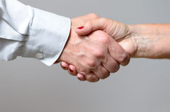Conceptual Handshake Gesture of Two Adult Hands Royalty Free Stock Photography