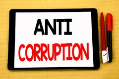 Conceptual handwriting text caption inspiration showing Anti Corruption. Business concept for Bribery Corrupt Text Written on tabl. Et, wooden background with Stock Photo