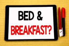 Conceptual handwriting text caption inspiration showing Bed Breakfast. Business concept for Holiday Journey Travel Written on tab. Let, wooden background with stock photography