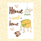 Conceptual handwritten phrase Home Sweet Home with chair, house shoes, bird's cage, birds. Royalty Free Stock Photos