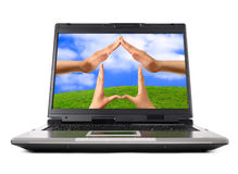 Conceptual Home Symbol. On a laptop computer display Real Estate Environmental technology concept Stock Images