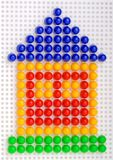 Conceptual home symbol made by color mosaic Royalty Free Stock Photography