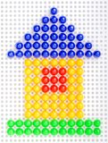 Conceptual home symbol made by color mosaic Royalty Free Stock Images