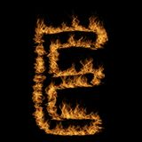 Hot fiery burning flame font. Conceptual hot fiery burning flame font made of blazing or raging orange yellow fire isolated on black background. 3D illustration Stock Photo
