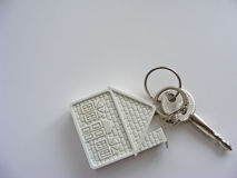 Conceptual house key isolated with place for writing. Conceptual house key on white background with place for writing Stock Image
