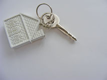 Conceptual house key isolated. Conceptual house key on white background Stock Photography