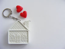 Conceptual house and red hearts isolated with place for writing. Conceptual house and red hearts on white background with place for writing Royalty Free Stock Photography