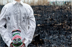 Conceptual Hurts shoot. Burned land, white shirt and colorful upside down head Royalty Free Stock Image