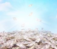 Conceptual illustration of the currency in cash on the sky backg. Round. Cash flow Royalty Free Stock Photography