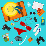 Conceptual illustration with some objects used modern people on vacation isolated on bright blue background or use in design. For card, poster, banner, placard Stock Photo